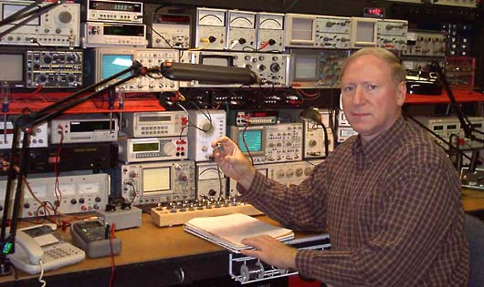 Photo of Keith Herron at test bench